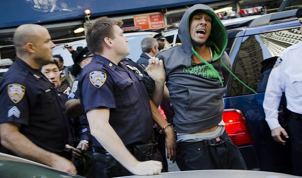 An Occupy Wall Street protestor is arrested after running from the police at Zuccotti Park on Tuesday, Sept. 17, 2013. The Occupy Wall Street movement marked its two year anniversary on Sept. 17, and turnout was noticeably lower than the previous year. Photo by Andy Mai.